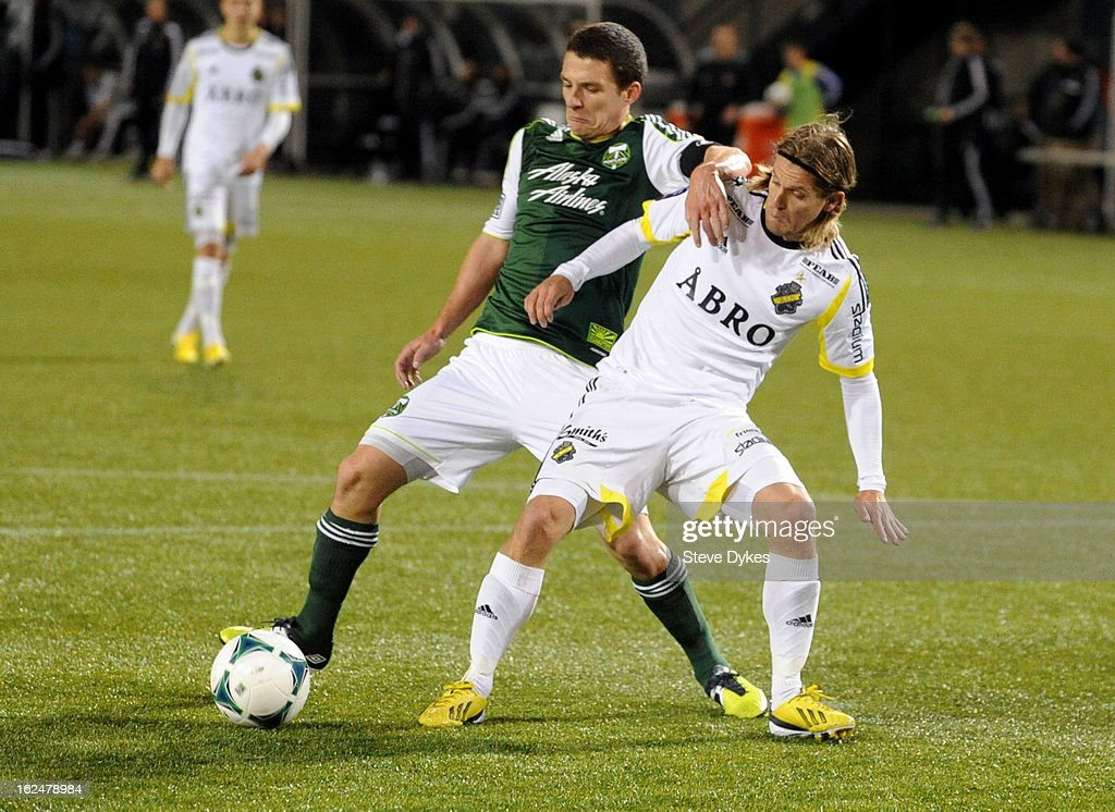 Diego Valeri #8 of the Portland Timbers battles for the ball with Martin Lorentzson #16 of AIK during the second half of the game at Jeld-Wen Field on February 23, 2013 in Portland, Oregon. The game ended in a 1-1 draw.