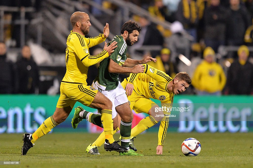 Diego Valeri #8 of the Portland Timbers maintains control of the ball as Federico Higuain #10 of the Columbus Crew SC and Will Trapp #20 of the Columbus Crew SC defend in the second half on December 6, 2015 at MAPFRE Stadium in Columbus, Ohio. Portland defeated Columbus Crew SC 2-1 to claim the MLS Cup title.