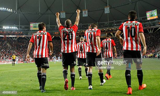 Diego Vera of Estudiantes celebrates with teammates after scoring the opening goal during a second leg match between Estudiantes and Gimnasia y...