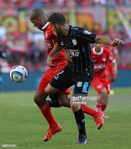 Diego Vera of Independiente and Nicolas Sanchez of Racing Club vie for the ball during a first leg match between Independiente and Racing Club as...