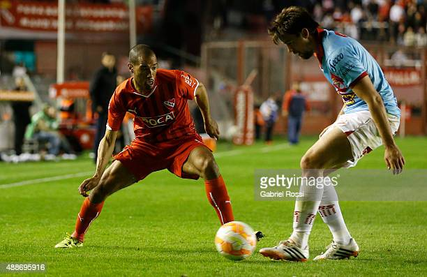 Diego Vera of Independiente fights for the ball with Mati'as Sarulyte of Arsenal during a second leg match between Independiente and Arsenal FC as...