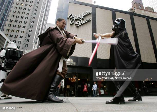 Diehard fans Freddie Crespo Jr and Sachiko Nahagone battle it out with their light sabers as they wait to see 'Star Wars Episode III Revenge of the...