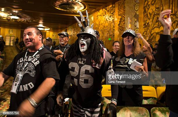 Diehard Raider fan Ray Perez in costume middle cheers with other fans as Raiders owner Mark Davis speaks during a town hall meeting with NFL...