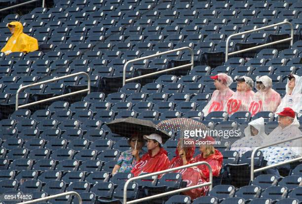 Dieheart fans sit out a rain delay during a MLB game between the Washington Nationals and the San Diego Padres on May 28 at Nationals Park in...