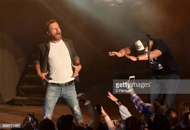Dierks Bentley brings a fan onstage to 'shotgun' a beer during his 'What The Hell' world tour at Shoreline Amphitheatre on August 20 2017 in Mountain...