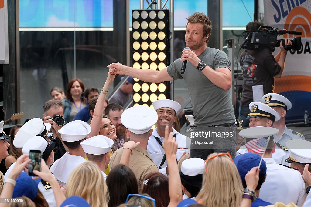 <a gi-track='captionPersonalityLinkClicked' href=/galleries/search?phrase=Dierks+Bentley&family=editorial&specificpeople=243007 ng-click='$event.stopPropagation()'>Dierks Bentley</a> holds <a gi-track='captionPersonalityLinkClicked' href=/galleries/search?phrase=Savannah+Guthrie&family=editorial&specificpeople=653313 ng-click='$event.stopPropagation()'>Savannah Guthrie</a>'s hand while performing on NBC's 'Today' at Rockefeller Plaza on May 27, 2016 in New York City.