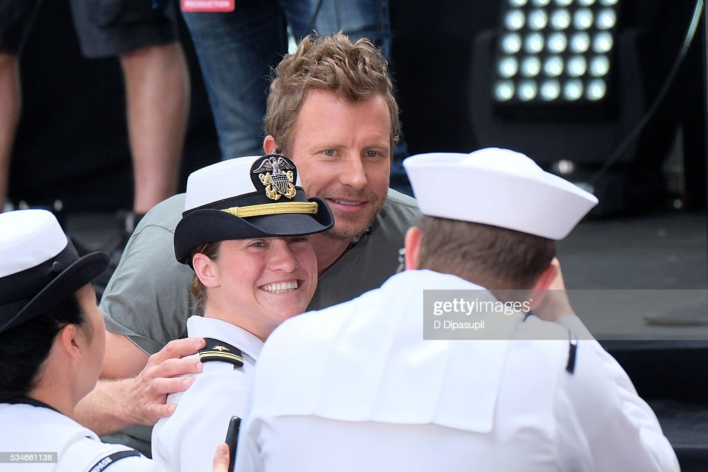 <a gi-track='captionPersonalityLinkClicked' href=/galleries/search?phrase=Dierks+Bentley&family=editorial&specificpeople=243007 ng-click='$event.stopPropagation()'>Dierks Bentley</a> (C) poses for a photo with a U.S. servicewoman during NBC's 'Today' at Rockefeller Plaza on May 27, 2016 in New York City.