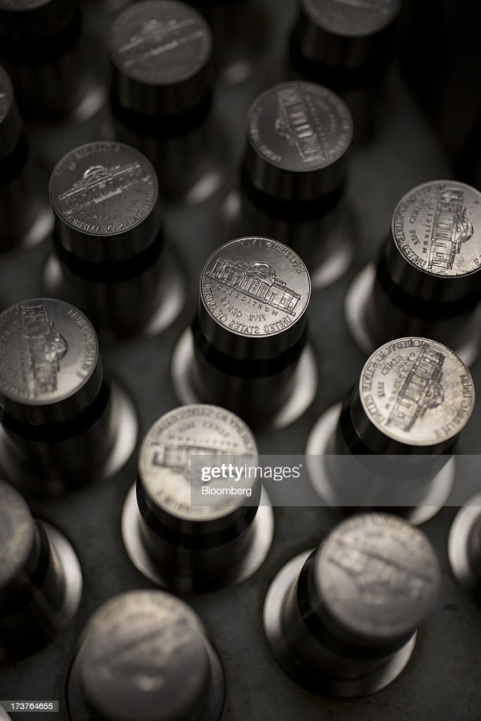 Dies used for pressing nickels sit in a tray at the U.S. Mint in Philadelphia, Pennsylvania, U.S., on Wednesday, July 17, 2013. Some sources of declining inflation 'are likely to be transitory' and expectations for future price increases 'have generally remained stable,' Ben S. Bernanke, chairman of the U.S. Federal Reserve said in prepared remarks. Photographer: Scott Eells/Bloomberg via Getty Images