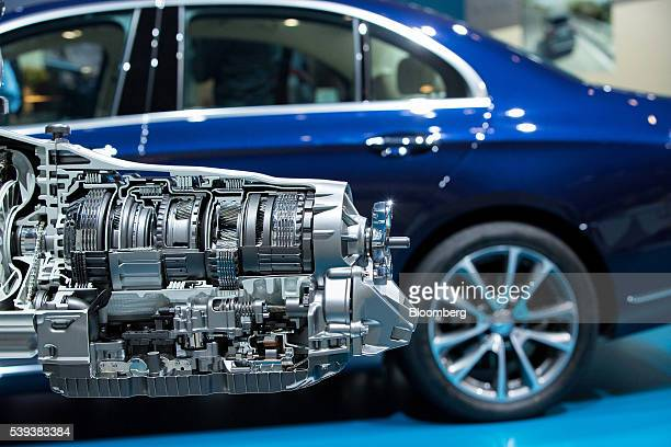 A diesel allaluminum 4cylinder OM 654 unit combustion engine sits on display beside a MercedesBenz E220 automobile during Daimler AG's TecDay Road to...