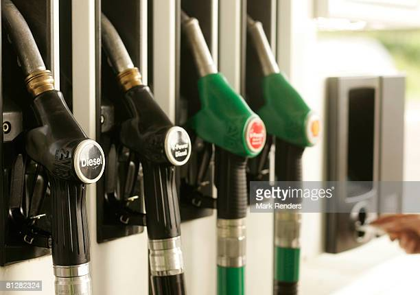Diesel and petrol pump nozzles at a fuel station forecourt on May 29 2008 in Luxembourg city Customers are driving up to 100 km from neighbouring...