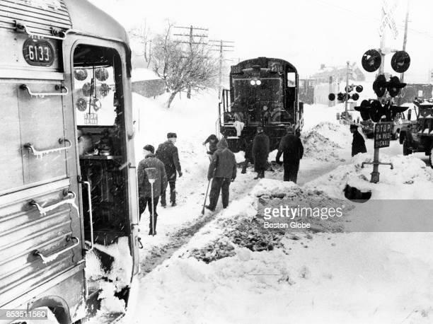 A diesel engine derailed in the snow at Topsfield Road in Ipswich Mass Feb 25 1969
