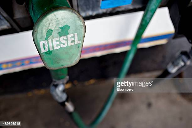 A diesel fuel pump sits in a cradle at a gas station in Princeton Illinois US on Wednesday Sept 23 2015 Volkswagen AG Chief Executive Officer Martin...