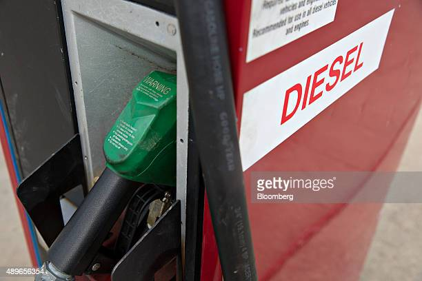 A diesel fuel pump sits in a cradle at a gas station in Tiskilwa Illinois US on Wednesday Sept 23 2015 Volkswagen AG Chief Executive Officer Martin...