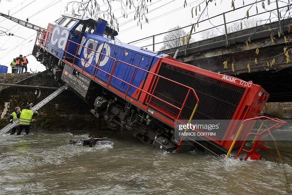 A diesel locomotive has ended up in the river Venoge on March 8, 2013 near Penthalaz, Western Switzerland. The freight locomotive derailed near Cossonez railway station with its driver slightly injured.