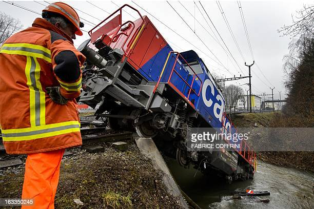A diesel locomotive has ended up in the river Venoge on March 8 2013 near Penthalaz Western Switzerland The freight locomotive derailed near Cossonez...