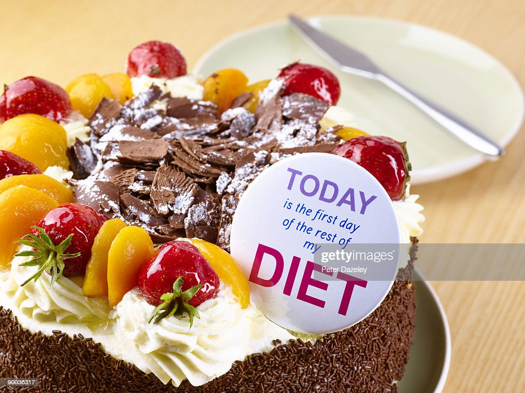 Diet badge on chocolate cream gateaux : Stock Photo