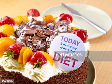 Diet badge on chocolate cream gateaux : Stock Photo