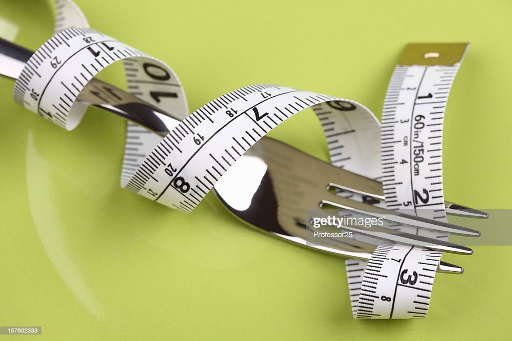 Diet Concept (Fork and tape measure)