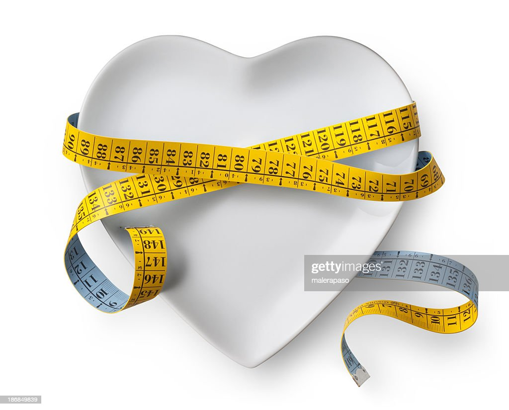 Diet. Heart shaped dish with measuring tape.