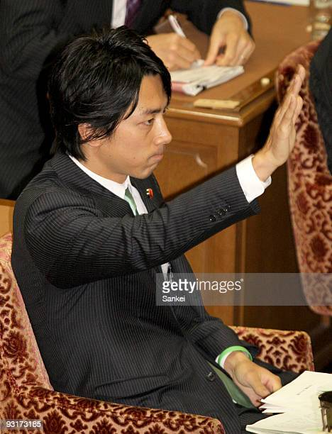 Diet member Shinjiro Koizumi raises his hand for questions at the Lower House Cabinet Committee at the lower house building on November 18 2009 in...