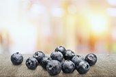 Fresh ripe blueberries on wooden table