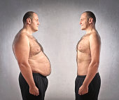 Fat man standing in front of his fitter clone