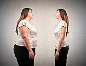fat woman and woman lean in comparison on gray background