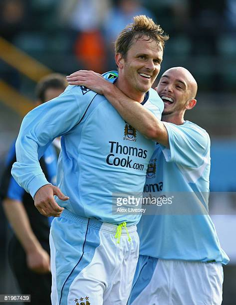 Dietemar Hamann of Manchester City celebrates with Stephen Ireland after scoring the second goal during the UEFA Cup 1st Round 1st Leg Qualifying...