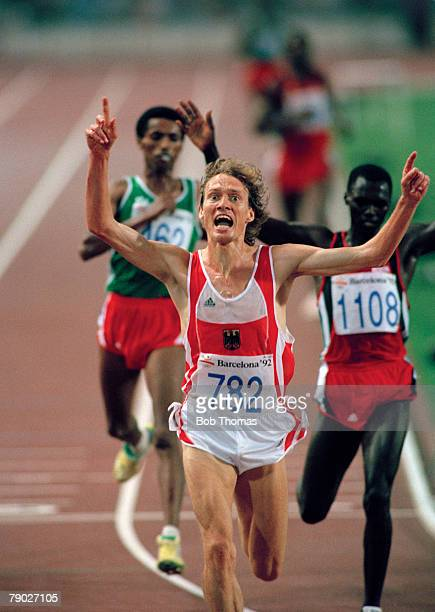 Dieter Baumann of Germany crosses the finish line in first place to win the gold medal in the final of the Men's 5000 metres event at the 1992 Summer...