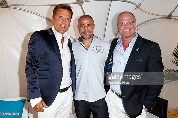 Dieter Bohlen Arthur Abraham and Thomas Finkbeiner attend the Camp David And Soccx Fashion Night 2013 at Event Island Berlin on July 3 2013 in Berlin...