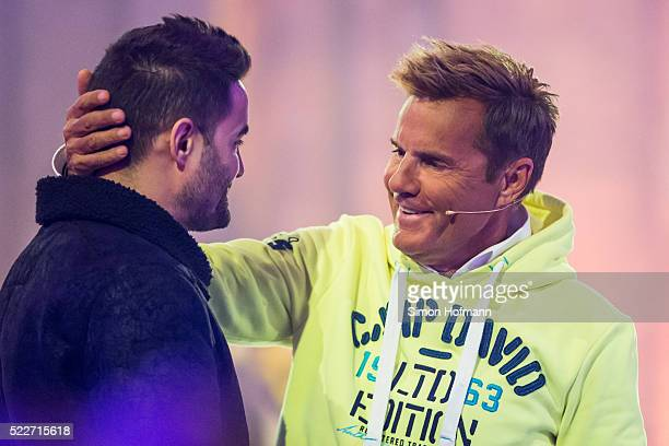 Dieter Bohlen hugs Menderes during the second event show of the tv competition 'Deutschland sucht den Superstar' at Eberbach Abbey on April 20 2016...