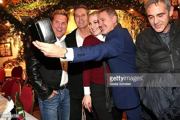 Dieter Bohlen Rupert Everett Kathrin Glock and Simon Bowman take a selfie during the Gut Aiderbichl Christmas Market 2015 opening on November 10 2015...
