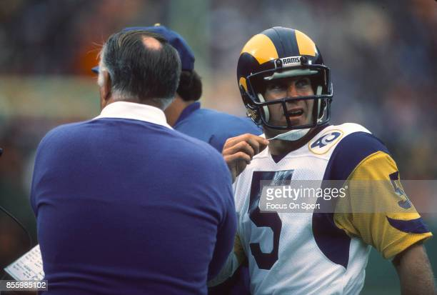 Dieter Brock of the Los Angeles Rams talks with head coach John Robinson against the Kansas City Chiefs during an NFL football game October 20 1985...