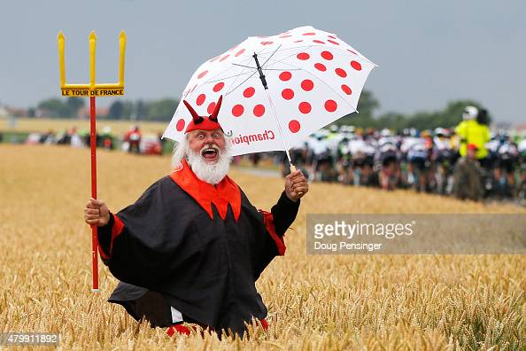 Dieter 'Didi' Senft the self styled 'Devil' of the Tour de France cheers on the riders during stage five of the 2015 Tour de France a 1895km stage...