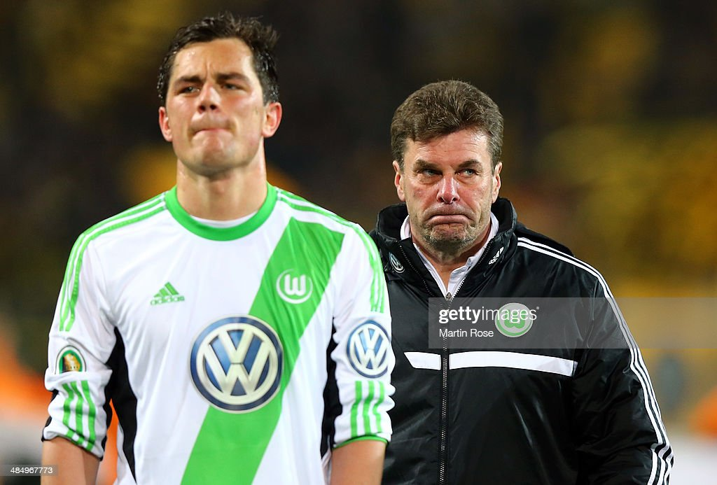 Dieter Hecking (R), head coach of Wolfsburg looks dejected after the the DFB Cup Semi Final match between Borussia Dortmund and VfL Wolfsburg at Signal Iduna Park on April 15, 2014 in Dortmund, Germany.