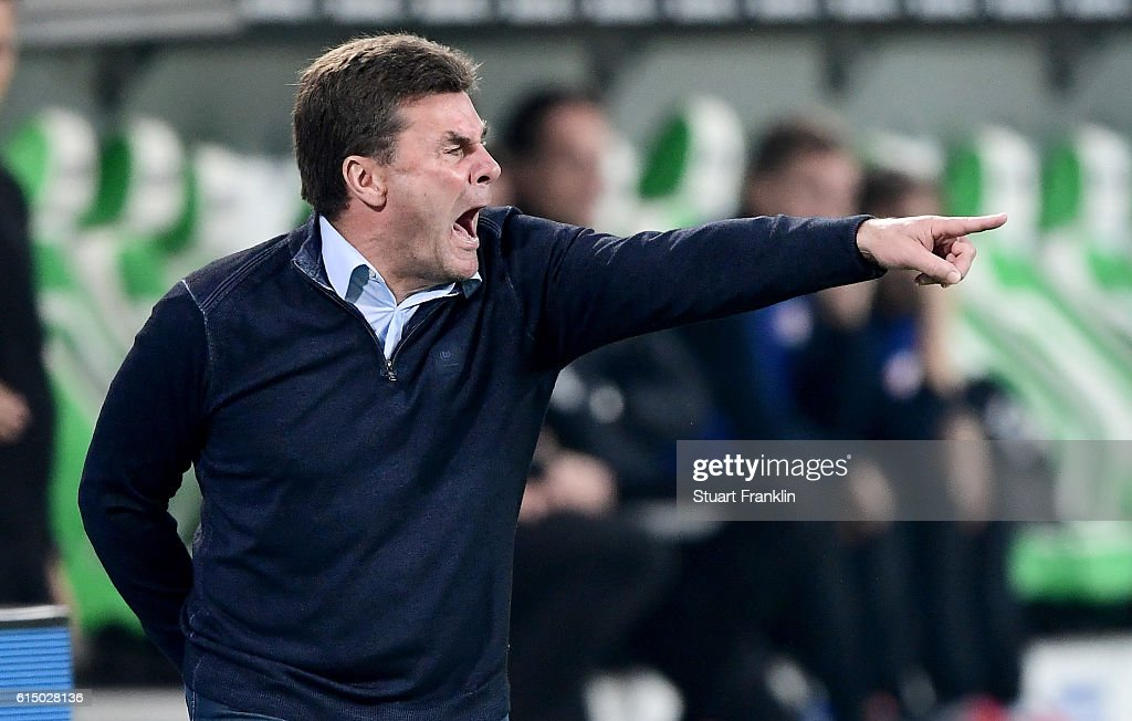 Dieter Hecking, head coach of Wolfsburg reacts during the Bundesliga match between VfL Wolfsburg and RB Leipzig at Volkswagen Arena on October 16, 2016 in Wolfsburg, Germany.
