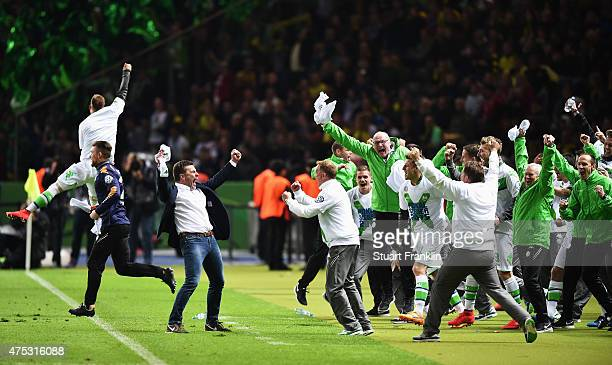 Dieter Hecking head cosch of Wolfsburg celebrates winning at the end of the DFB Cup Final between Borussia Dortmund and VfL Wolfsburg at...