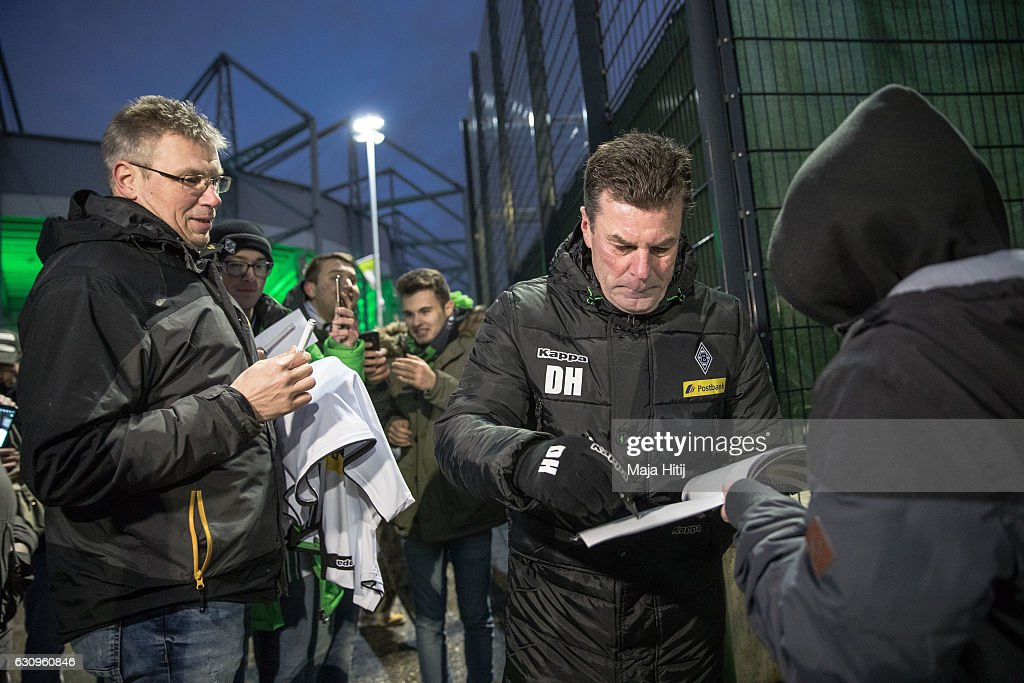 Dieter Hecking, the newly appointed head coach of Borussia Moenchengladbach gives an autograph after a training session on January 4, 2017 in Moenchengladbach, Germany.