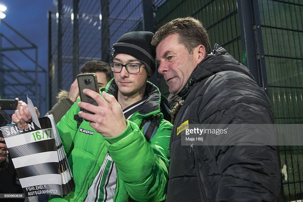 Dieter Hecking, the newly appointed head coach of Borussia Moenchengladbach poses with a fan after a training session on January 4, 2017 in Moenchengladbach, Germany.