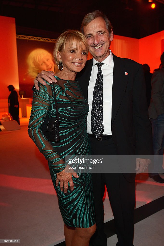 Dieter Herrmann and <a gi-track='captionPersonalityLinkClicked' href=/galleries/search?phrase=Uschi+Glas&family=editorial&specificpeople=213394 ng-click='$event.stopPropagation()'>Uschi Glas</a> attend the Ein Herz Fuer Kinder Gala 2013 at Flughafen Tempelhof on December 7, 2013 in Berlin, Germany.