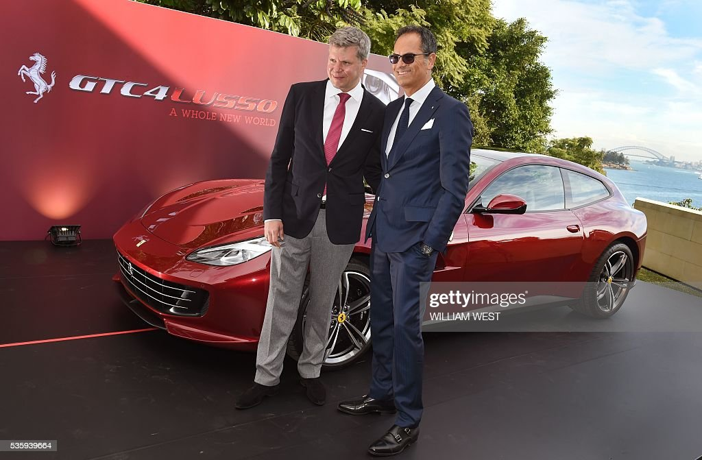 Dieter Knechtel, Ferrari Far East CEO (L) and Ferrari Senior Vice President of Design Flavio Manzoni (R) pose with the new Ferrari GTC4Lusso during the car's Australasian launch in Sydney on May 31, 2016. WEST