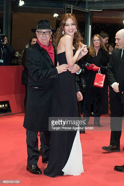 Dieter Kosslick and Olga Kurylenko attend the Closing Ceremony of the 65th Berlinale International Film Festival at Berlinale Palace on February 14...
