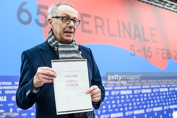 Dieter Kosslick Director of Berlinale Festival poses with an old certificate from 1951 for the Golden Bear for the film 'Cinderella' during the 65th...