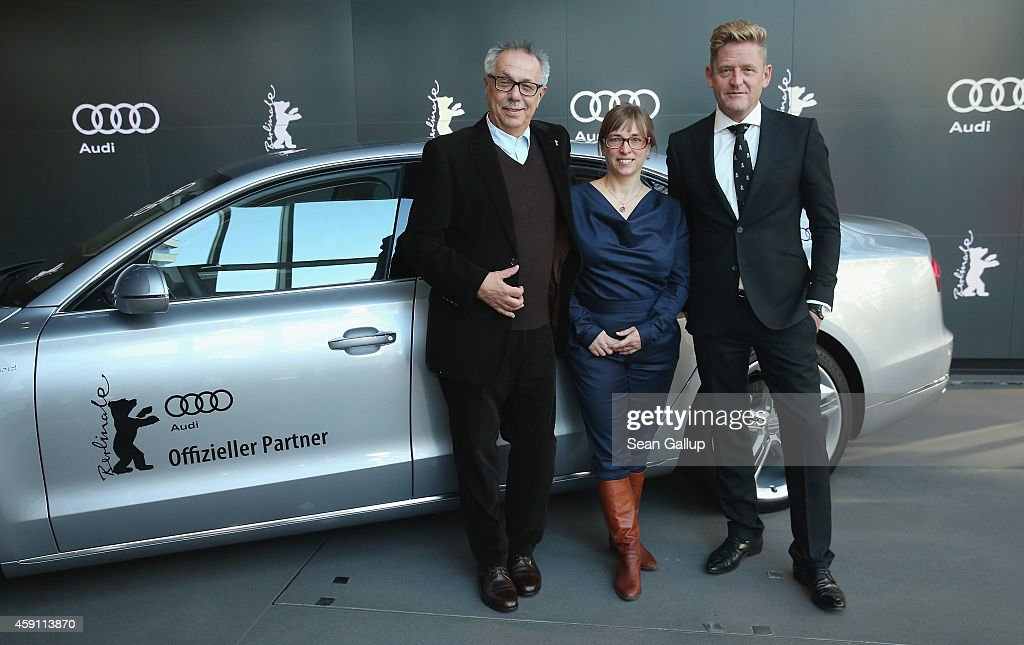 <a gi-track='captionPersonalityLinkClicked' href=/galleries/search?phrase=Dieter+Kosslick&family=editorial&specificpeople=213030 ng-click='$event.stopPropagation()'>Dieter Kosslick</a>, Director of the Berlinale International Film Festival, Maike Mia Hoehne, Curator of Berlinale Shorts, and Wayne Griffiths, Director of Sales Germany for Audi, pose in front of an Audi limousine at Audi City Berlin on November 18, 2013 in Berlin, Germany. Audi will provide transport at the 2015 Berlinale and also sponsor a short film award.