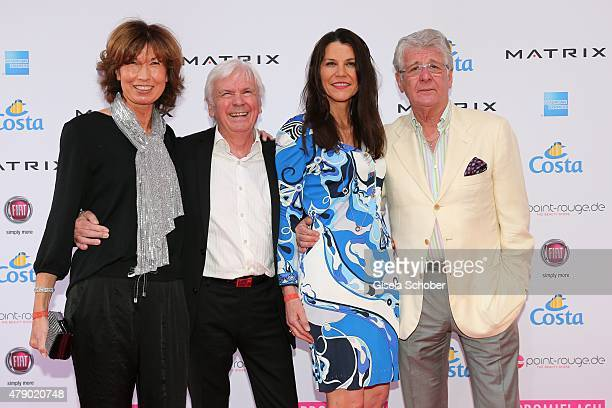 Dieter Kuerten and his wife Petra Kuerten Marcel Reif and his wife Marion Kiechle attend the Movie meets Media party during the Munich Film Festival...