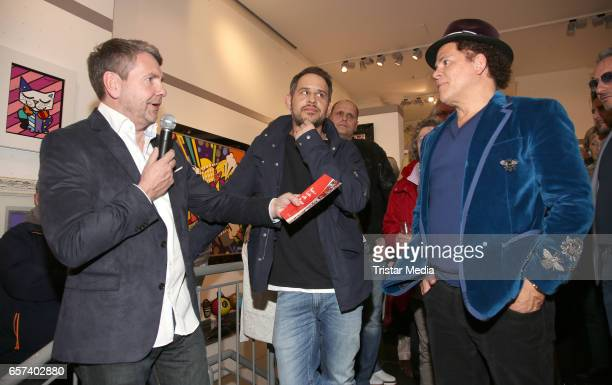 Dieter Metzger Moritz Bleibtreu and Romero Britto during the Vernissage 'Have A Coke With Romero Britto' in the Mensing galery on March 24 2017 in...