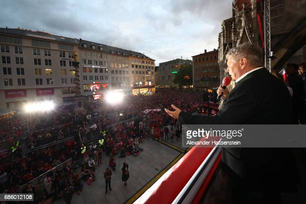 Dieter Reiter Mayor of Munich speaks to the fans as they celebrate winning the 67th German Championship title on the town hall balcony at Marienplatz...