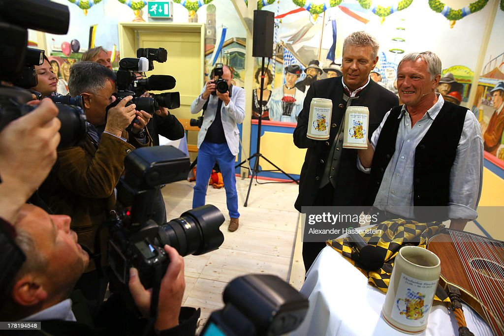 Dieter Reiter, Munich major candidate 2013 holds with comedian Josef Brustmann (R) the official 2013 Oktoberfest one-liter beer glass during a peresentation at Hacker Festzelt on the Theresienwiese three weeks ahead of Oktoberfest on August 27, 2013 in Munich, Germany. Munich Oktoberfest, which opens to the public on September 21, draws millions of visitors and is the biggest beer fest in the world.