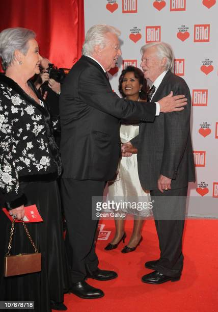 Dieter Thomas Heck flanked by his wife Ragnhild Heck greets Karlheinz Boehm at the 'Ein Herz Fuer Kinder' charity gala at Axel Springer Haus on...