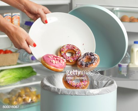 Dieter throwing away donuts
